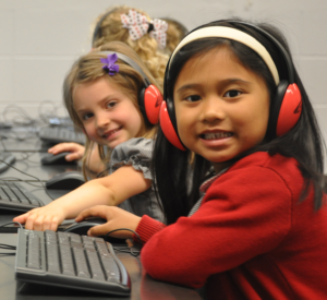 Kindergarten children study and smile while learning in the computer lab